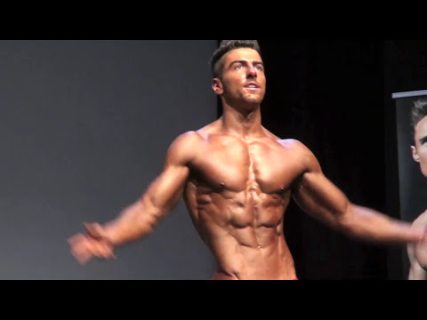 MOST RIPPED SEXY FITNESS MODEL WINS FIRST COMPETITION