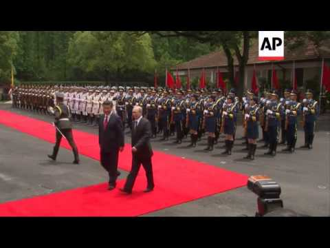 Russian President Putin holds talks with Chinese counterpart in Shanghai