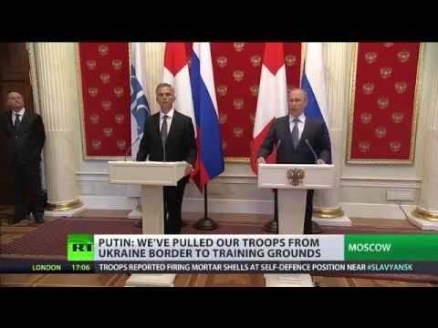 Russian troops pulled back from Ukraine border by Putin