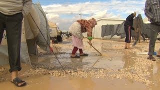 Syrian refugees in cold, wind, rain