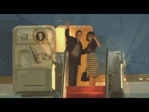 Obama family leave on Air Force One for G8 summit: President, Michelle and Malia Obama