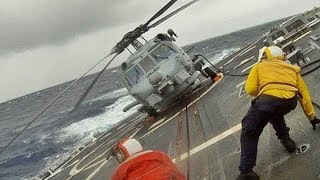 EXTREME SKILLS: Amazing military helicopter landing on ship deck in rough seas