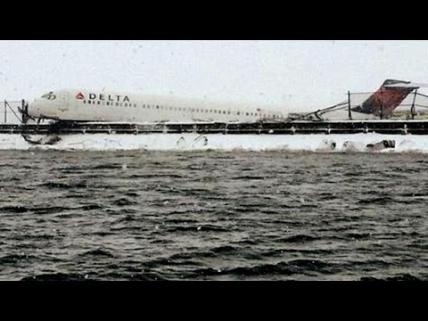 Airliner skids off La Guardia runway as winter storm hits US