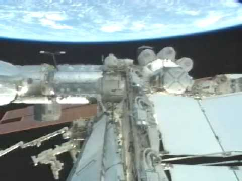 External camera view of the ISS and Earth.