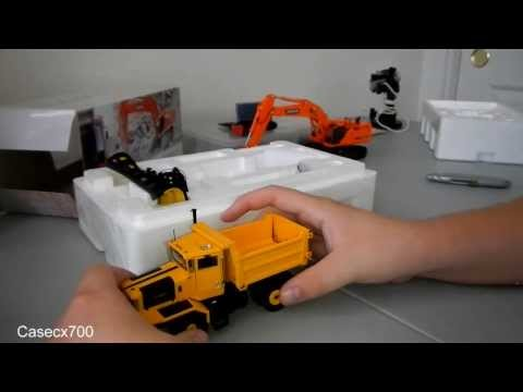 Unboxing the 1:50 scale Doosan DX700 along with a Shuttle Lift carry deck crane and 2 Oshkosh P Series Plow trucks. Casecx700 on Facebook https://www.facebook.com/Casecx700.