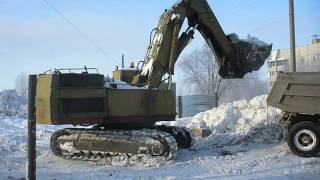 "Old soviet excavator ЭО-5123 wit front shovel loadin"" snow"