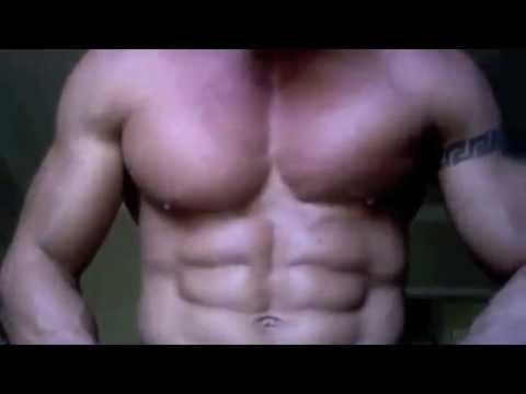 Bodybuilder Flexing Pecs And Biceps video