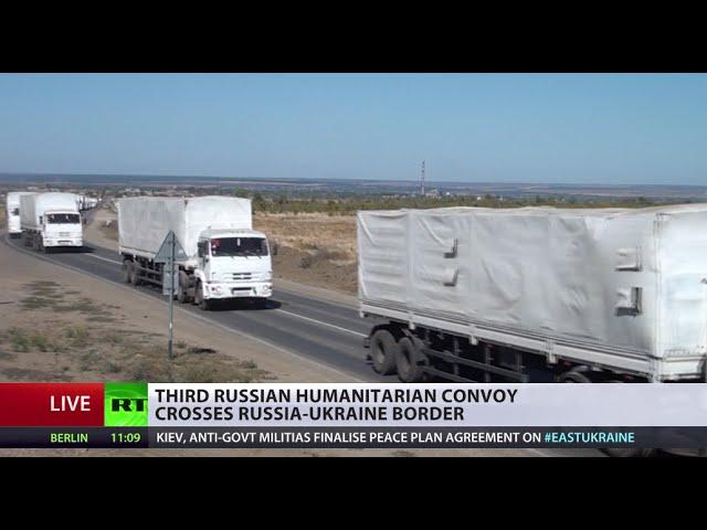 3rd Russian Convoy: Trucks deliver aid to war-torn E. Ukraine