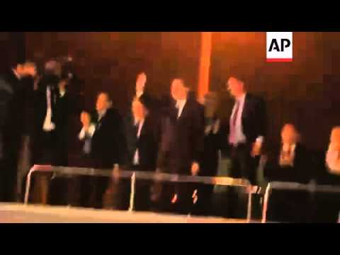 Supporters cheer on Erdogan as he returns from North Africa tour