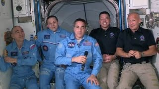 SpaceX Dragon astronauts welcomed to International Space Station