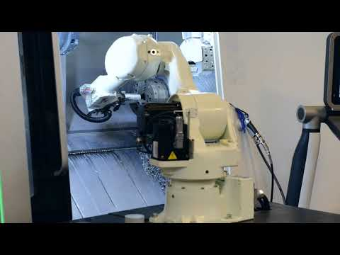 Loading CNC lathe with robotic