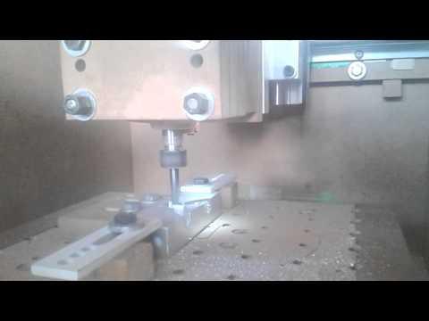 MDF cnc milling it's own aluminium parts