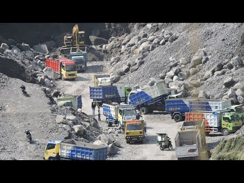 Busy Excavator And Dump Truck Working In Quarry