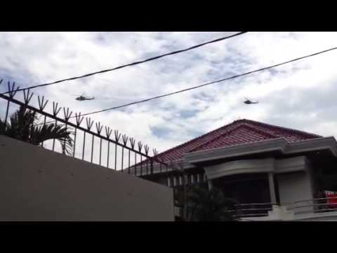 Convoy of chopper through residential area of Pondok Indah