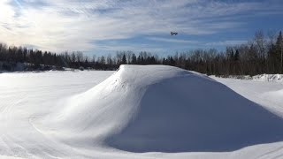 Awesome,hpi vorza on hard snow doing front flip and big jumping.