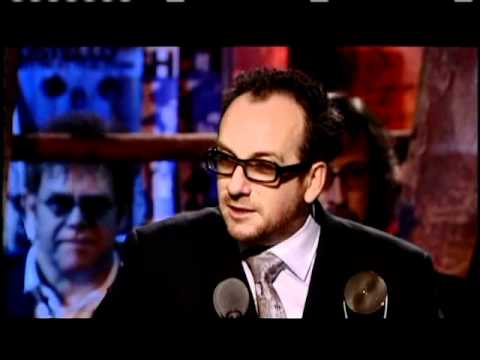 Elvis Costello and the Attractions accept award Rock and Roll Hall of Fame inductions 2003