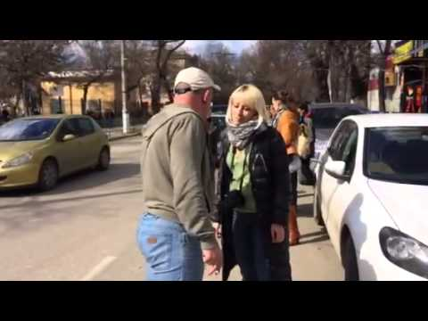 Pro-Russian man shouts at woman who held peace sign in Simferopol