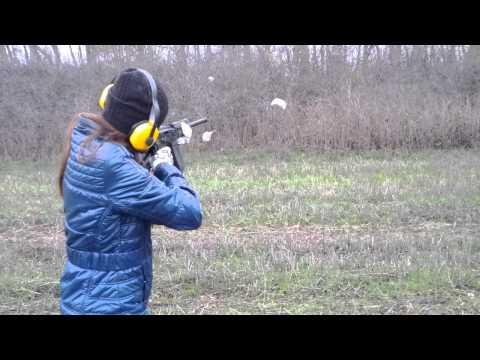 Маша стреляет из Сайги-12С