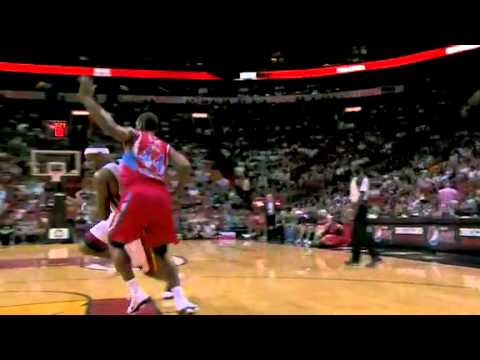 LeBron James drives and Assist Zydrunas Ilgauskas before fall down Miami Heat Preseason