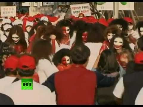 Naked sex workers try to set themselves on fire in Seoul protest