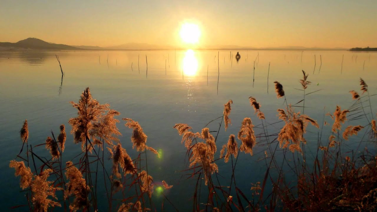 Umbria lago trasimeno al tramonto sunset on lake for Immagini hd natura