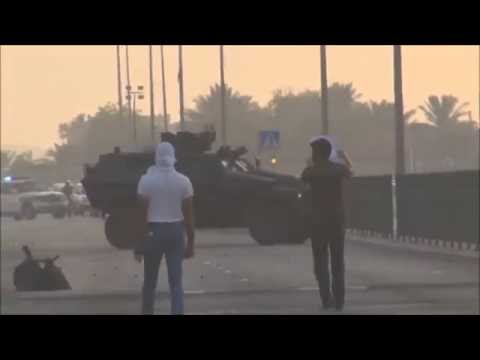 Bahrain : Riot Police Armoured vehicles Attack Peaceful Protesters Heavily By Multiple Tear Gases