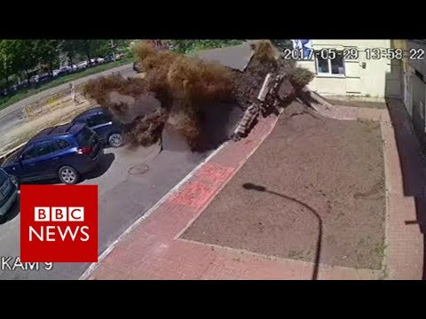 Dramatic Ukraine water pipe explosion captured on CCTV - BBC News