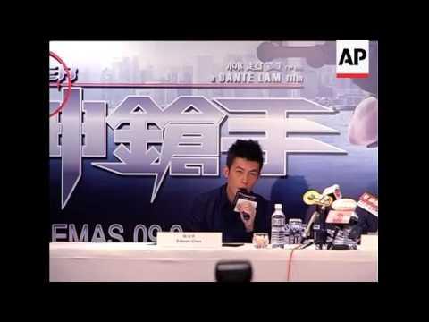 Actor Edison Chen appears in public in Singapore despite death threat.