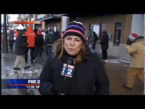 Happy New Year! For my first video of 2014, I'd like to introduce you to an overzealous Red Wings fan who tried to jump behind a reporter from FOX 2 in Detro...