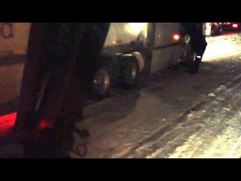 FedEx putting chains on in Ga winter snow 2014. Atlanta shut down