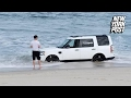 Beached SUV is nearly swept out to sea   New York Post