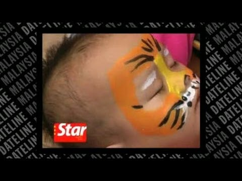 Face painting in support of saving tigers