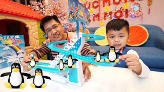 TRÒ CHƠI CÔNG VIÊN TRƯỢT TUYẾT CHIM CÁNH CỤT ĐỒ CHƠI   Jolly Penguin Frisk Paradise Toy For Kids