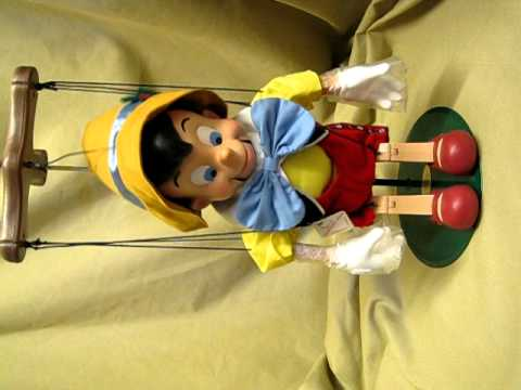 Disney classic holiday singing animated pinocchio puppet marionette