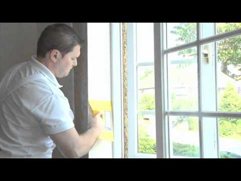 Fitting Sempatap Thermal Solid Wall Insulation around window reveals