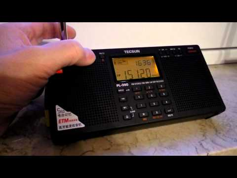 DSP-Radio TECSUN PL-390 and GRUNDIG G5 - Voice of Nigeria - 29.12.2010