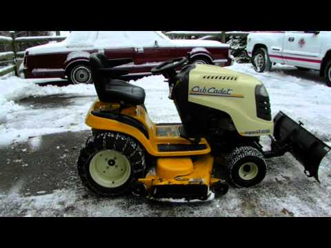How to plow your driveway with a lawn tractor with a snow plow