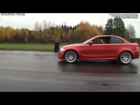 BMW 1M Coupe vs BMW M6 Coupe from a rolling start and from standstill on the wet