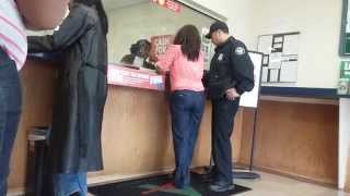 How To Get Arrested, Lady gets arrested for check fraud at a check cashing store.