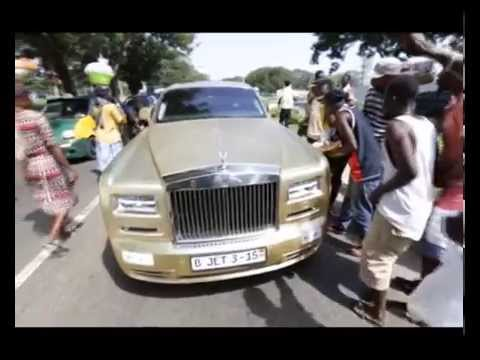 Asamoah Gyan lands in Accra with his gold Rolls Royce