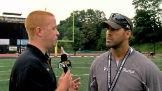 Towson Football's Fullback/Tight Ends Coach Reno Ferri chats with TSN following practice
