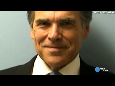 Rick Perry smiles in mug shot, then goes for ice cream