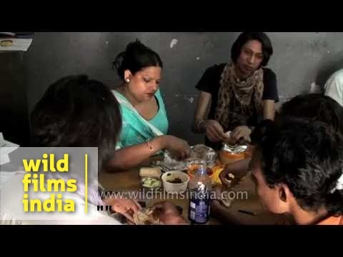 Indian transgender hijra lunches during a routine day of work