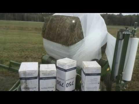 Обмотчик рулонов для упаковки  сенажа в полимерную пленку.