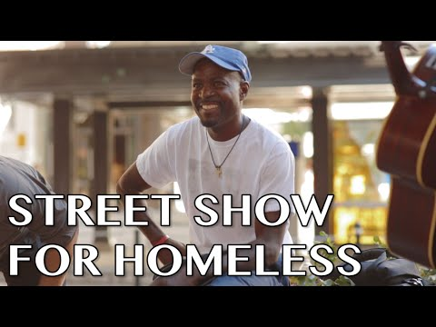 Street Musicians Perform with Man In Need