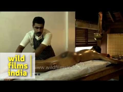 Male therapist delivers Kerala Ayurveda massage in India