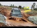 Toyota fortuner crawling through mud