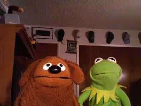 Kermit shows Rowlf the Dog