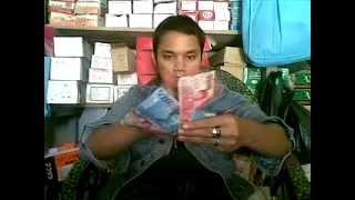 Mengambil uang gaib