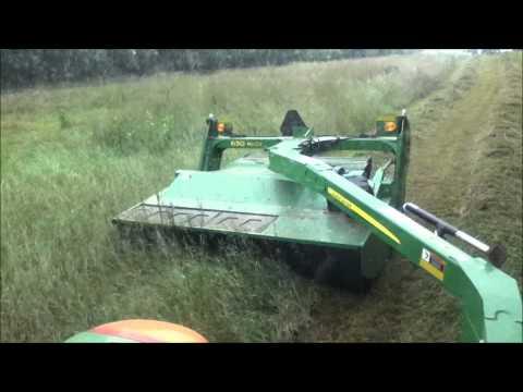 John Deere 6330 Premium mowing hay